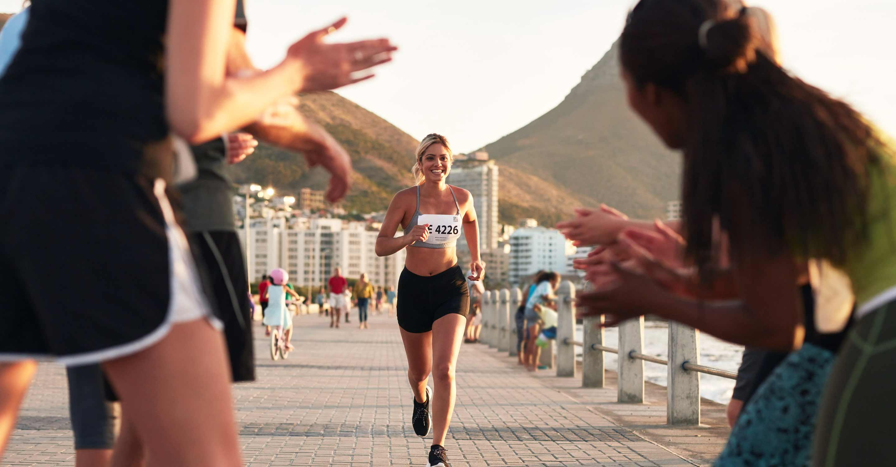 Photo of woman jogger racing to the finish line.