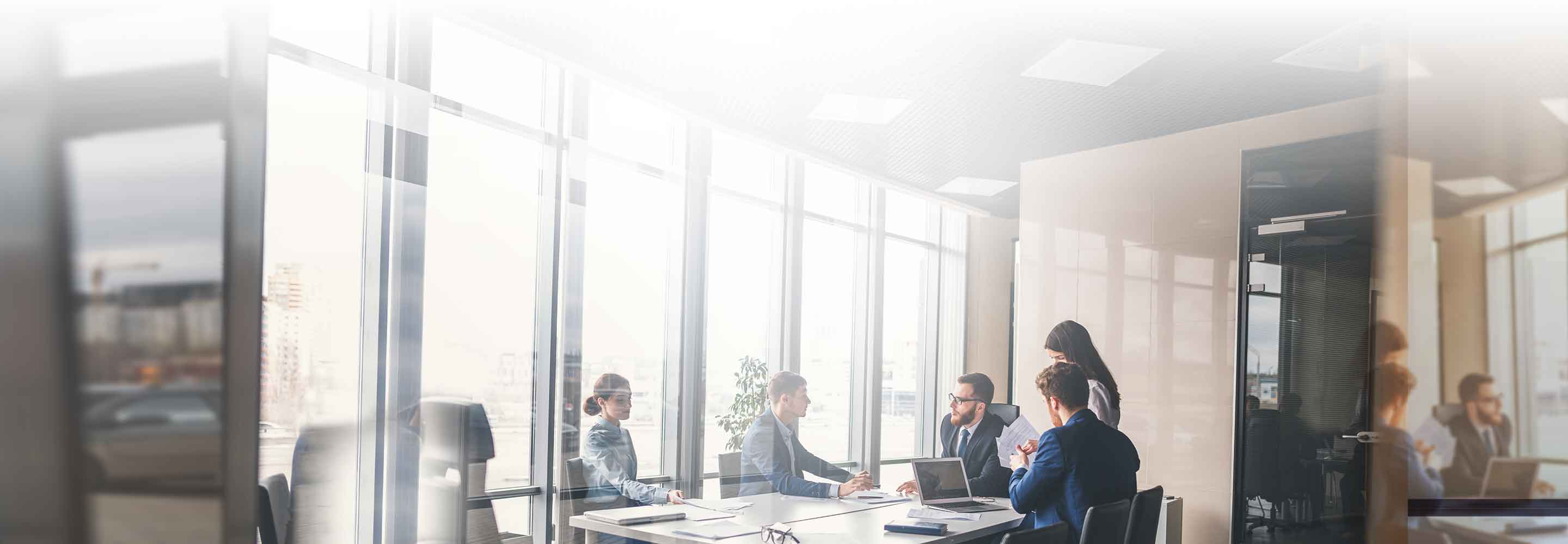 Coworkers discussing something in meeting room