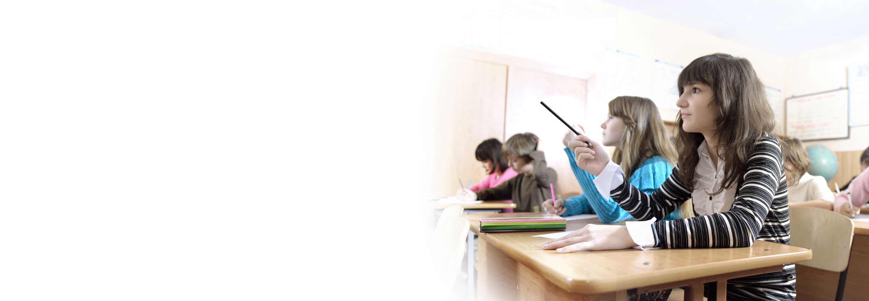 student pointing to whiteboard in class