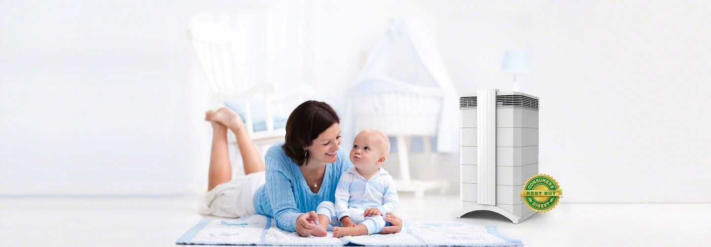 Baby and mother in nursery