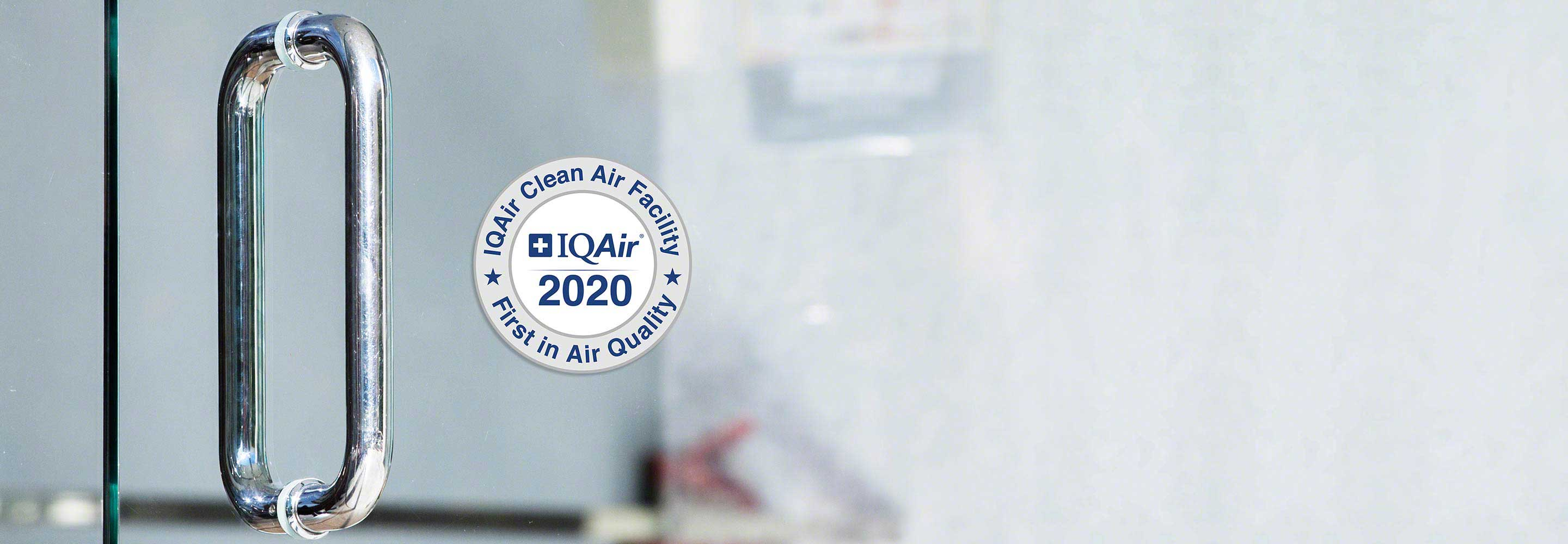 IQAir's Clean Air Facility Badge on glass door