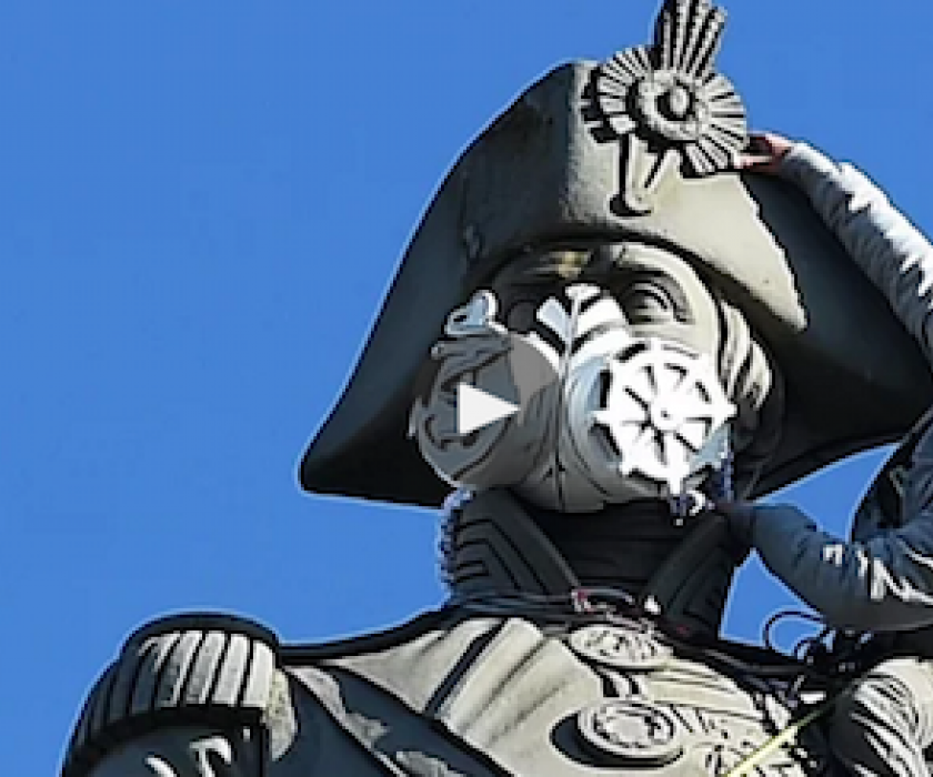 Mask being applied to Nelson's column