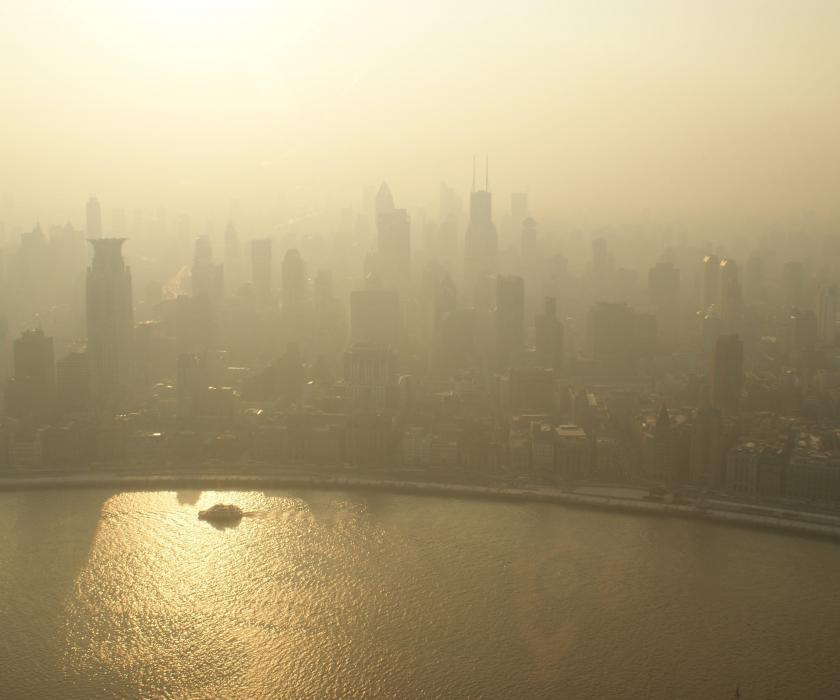 Hazy skies over city landscape