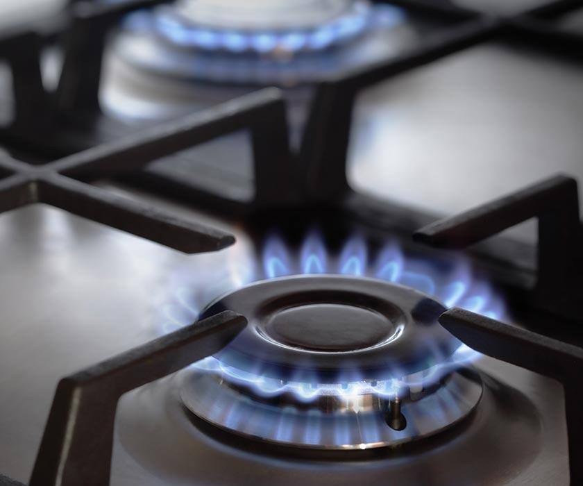 Flames over a gas stove