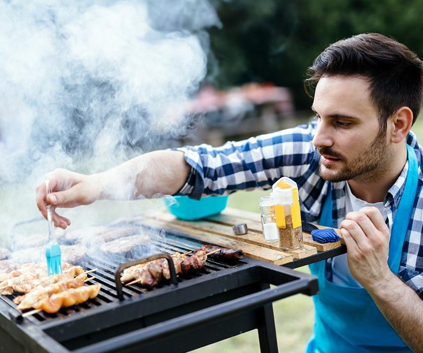Man barbecuing