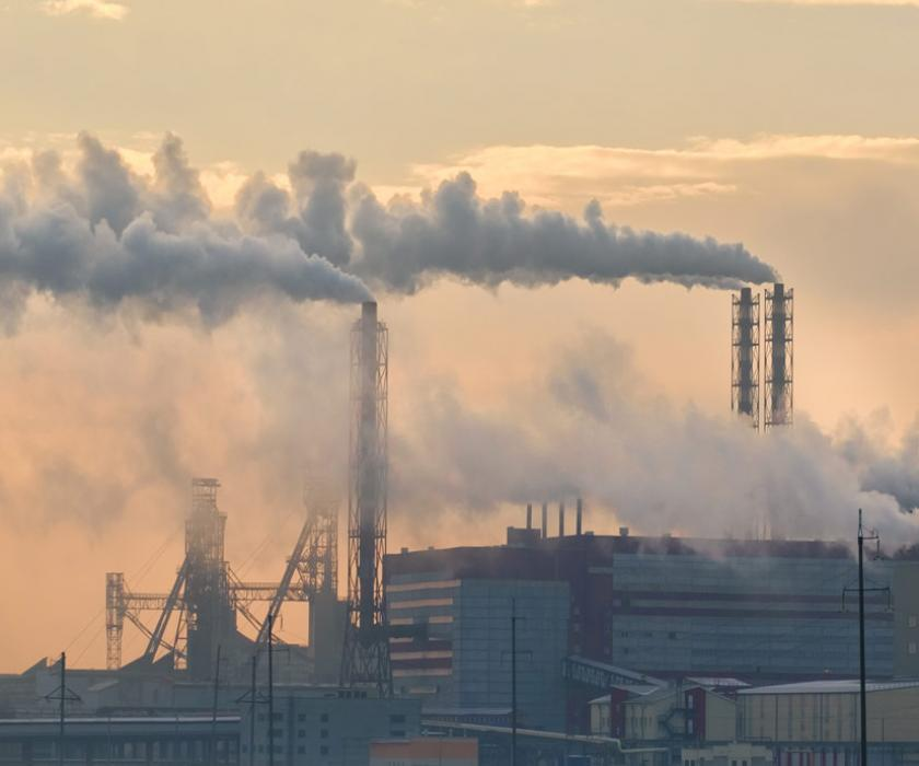 Production facility emitting pollution from smokestacks