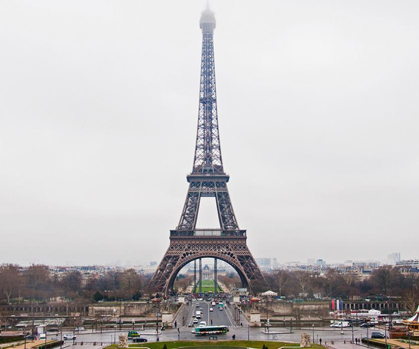 Eiffel Tower in Paris on a rainy day with clearly hazy background.