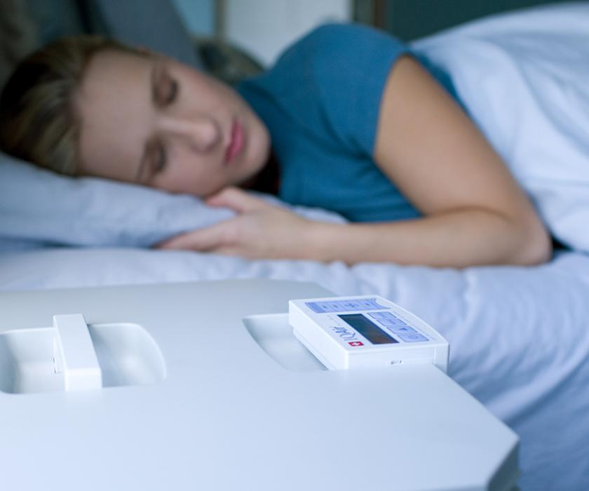 woman sleeping peacefully next to HealthPro Plus.